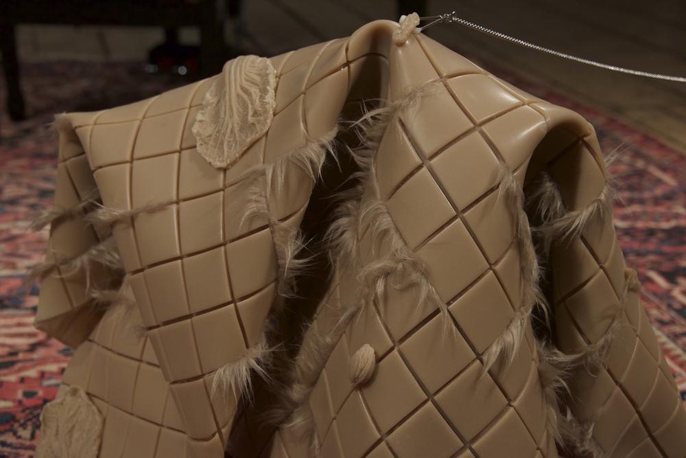 Hannah Levy  Non-slip Solutions , 2016 Cast epoxy, fiberglass, faux fur, nipple clamp, chain. 20.5 x 30 x 22 inches