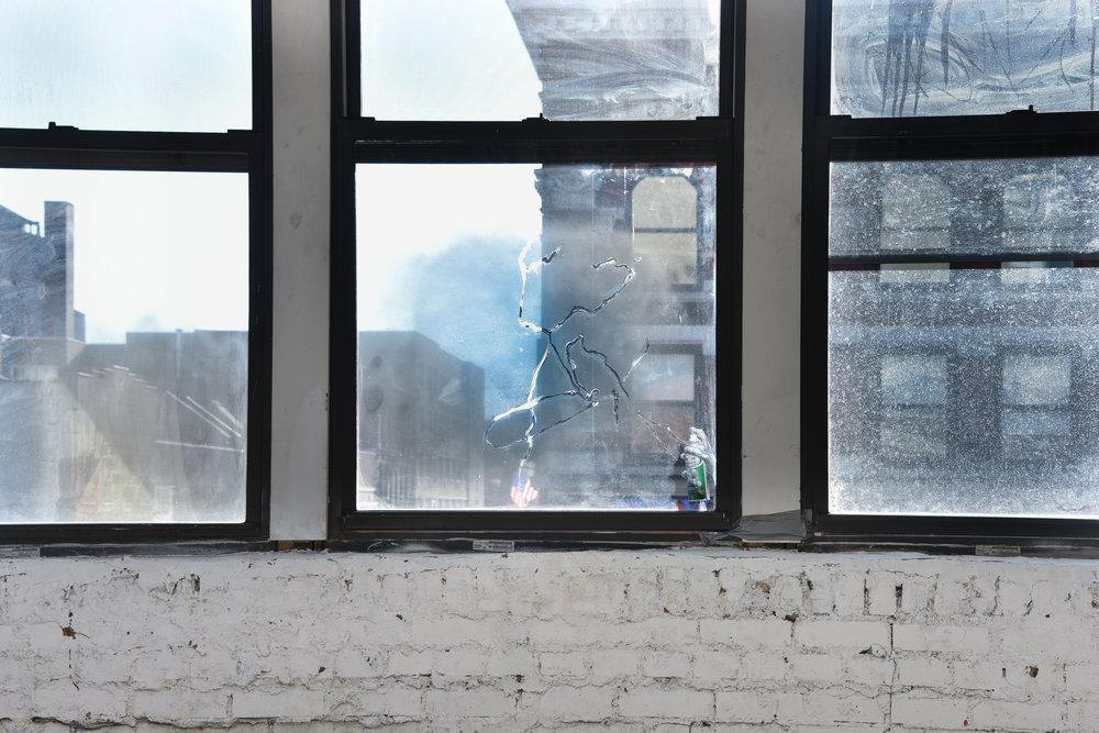 Hand Holds Mirror Spray,Irina Jasnowski Pascual Rustoleum Metallic spray paint can, resin, Rustoleum Mirror Finish spray paint can, mirror spray paint on window
