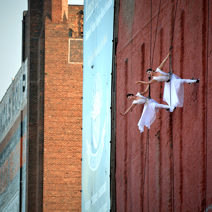 Quixotic performing on the side of a building