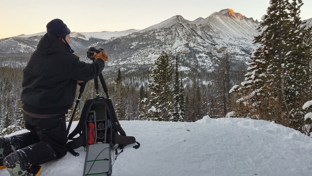 Mike sets up for a winter photograph with Longs Peak in Rocky Mountain National Park, Colorado while testing the MindShift Backlight 26L.