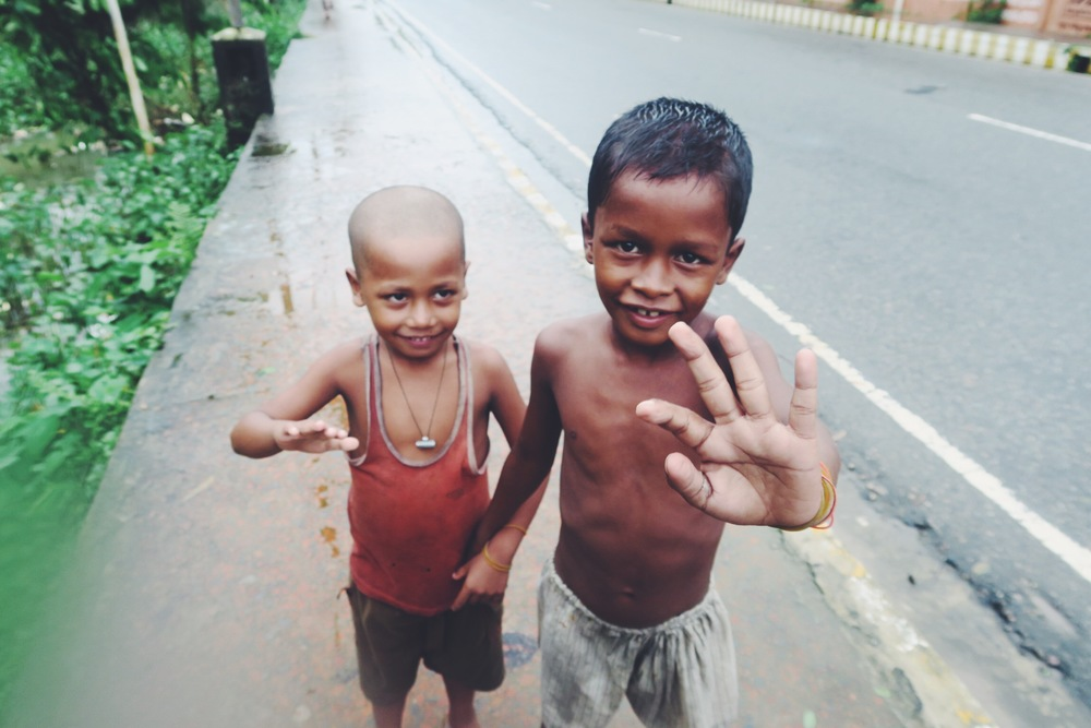 Two beautiful kids following us in the street