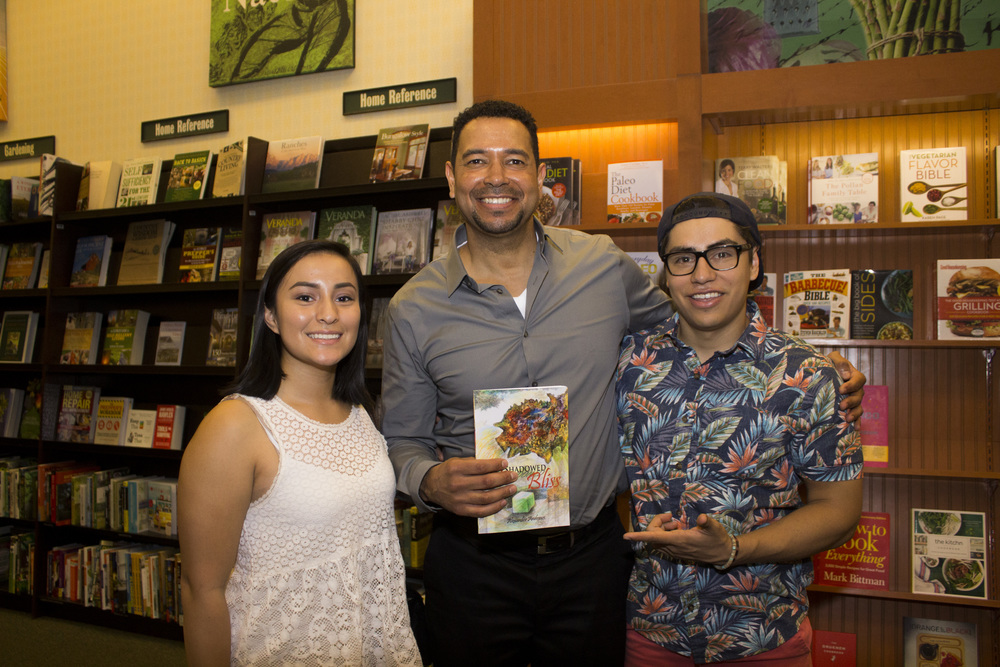 Professor and author Alexander Andrews takes a picture with some of his former students.