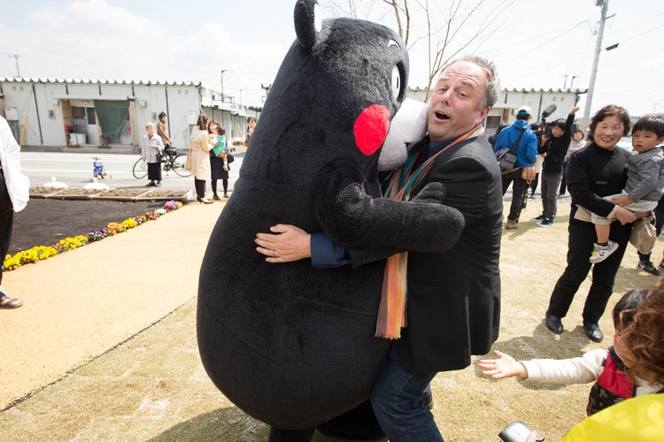 Mark Dytham having a hug with Kumamon