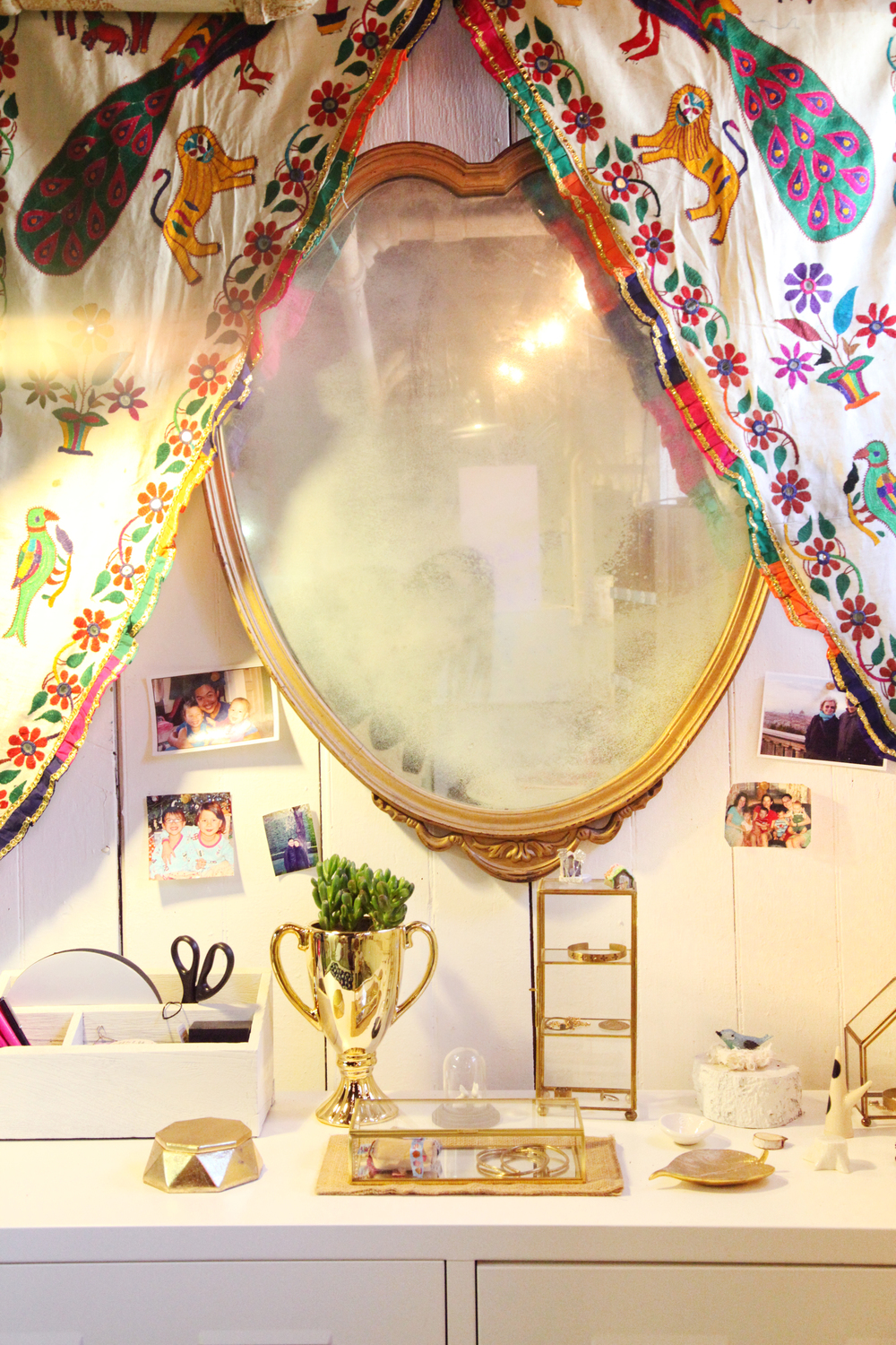 An old mirror and a fave textile make up my packaging area.