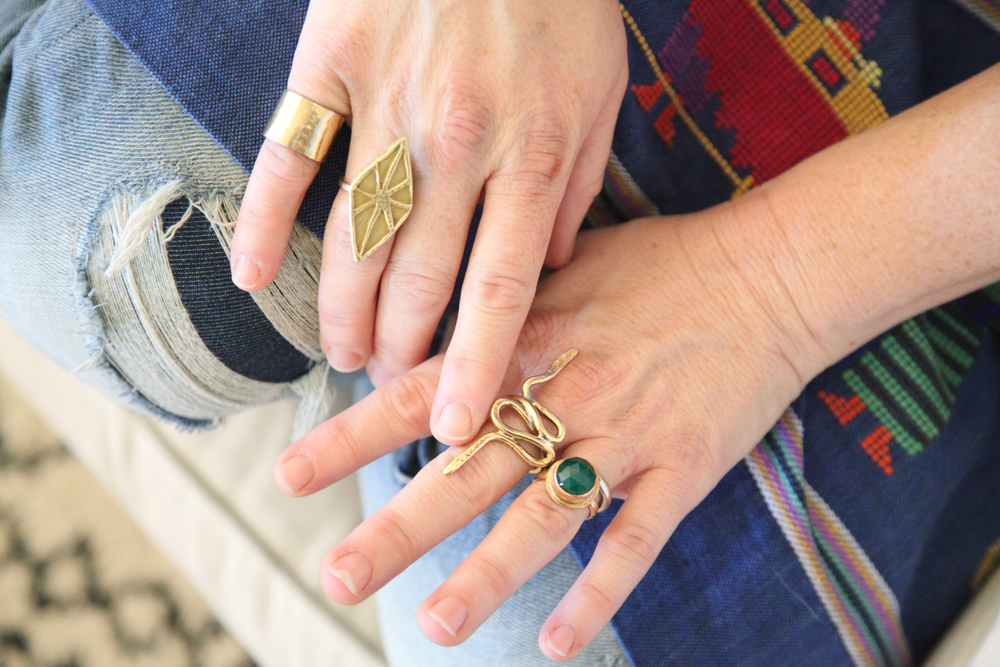 "A few of my rings ( wide band pinky ring,  "" Home""   from my current collection, double snake ring &   ""Hope""   from my classic collection)"