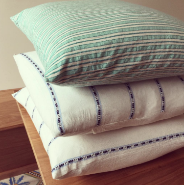 Piles of signature stripes from Heather Taylor Home Instagram
