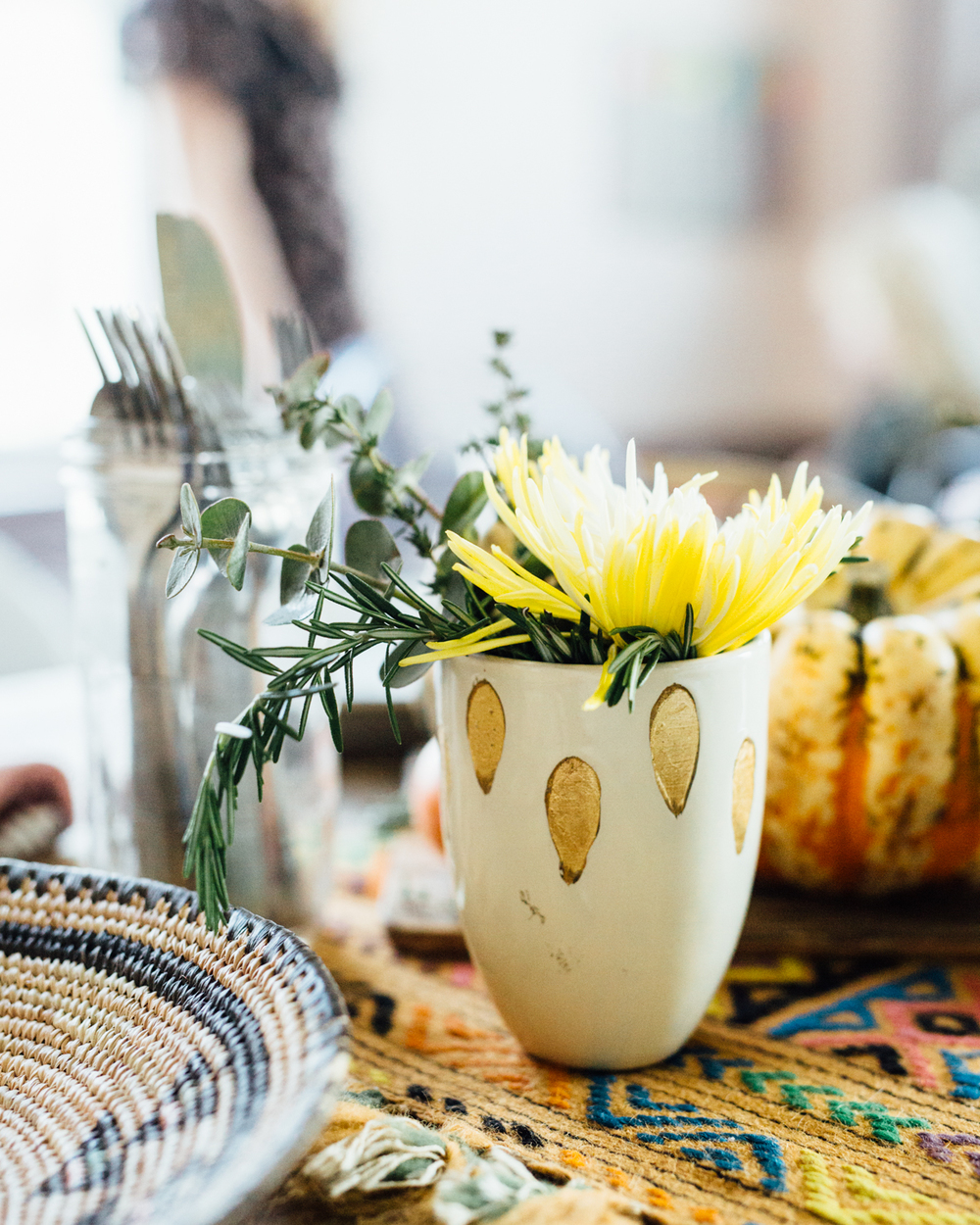 Try peppering in some fresh herbs into the flower arrangements for an edible garden that compliments your spread. Guests can help themselves to extra flavor.