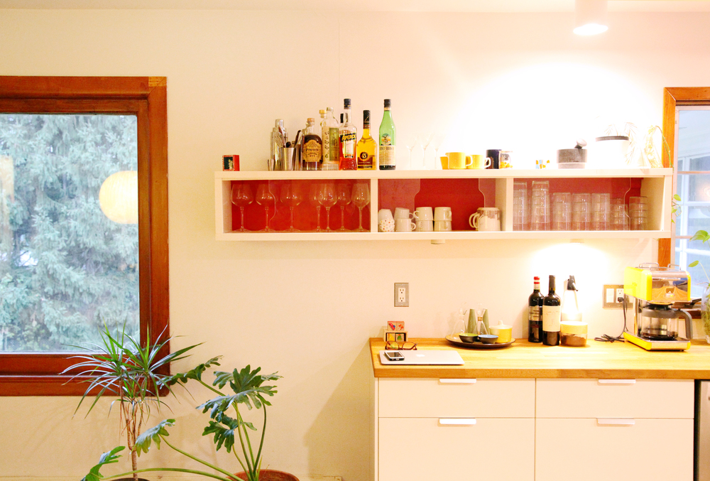 The magnificent kitchen window and a well-appointed liquor shelf.