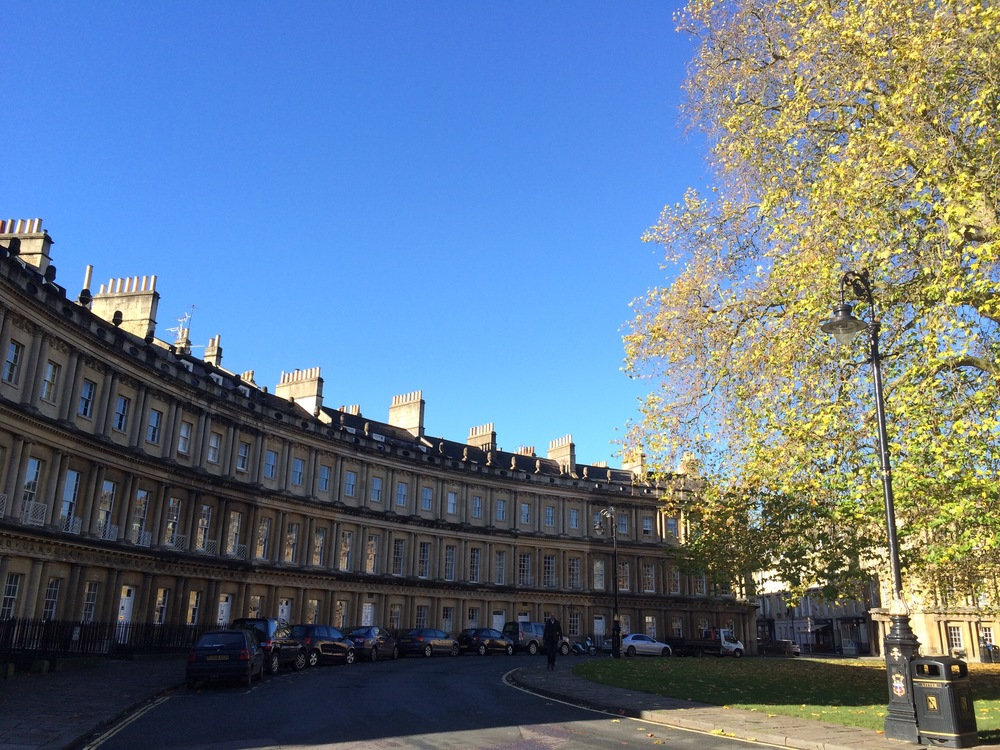 Bath is known for its Georgian architecture and natural hot springs. A proper tree-lined street with too many windows to count.