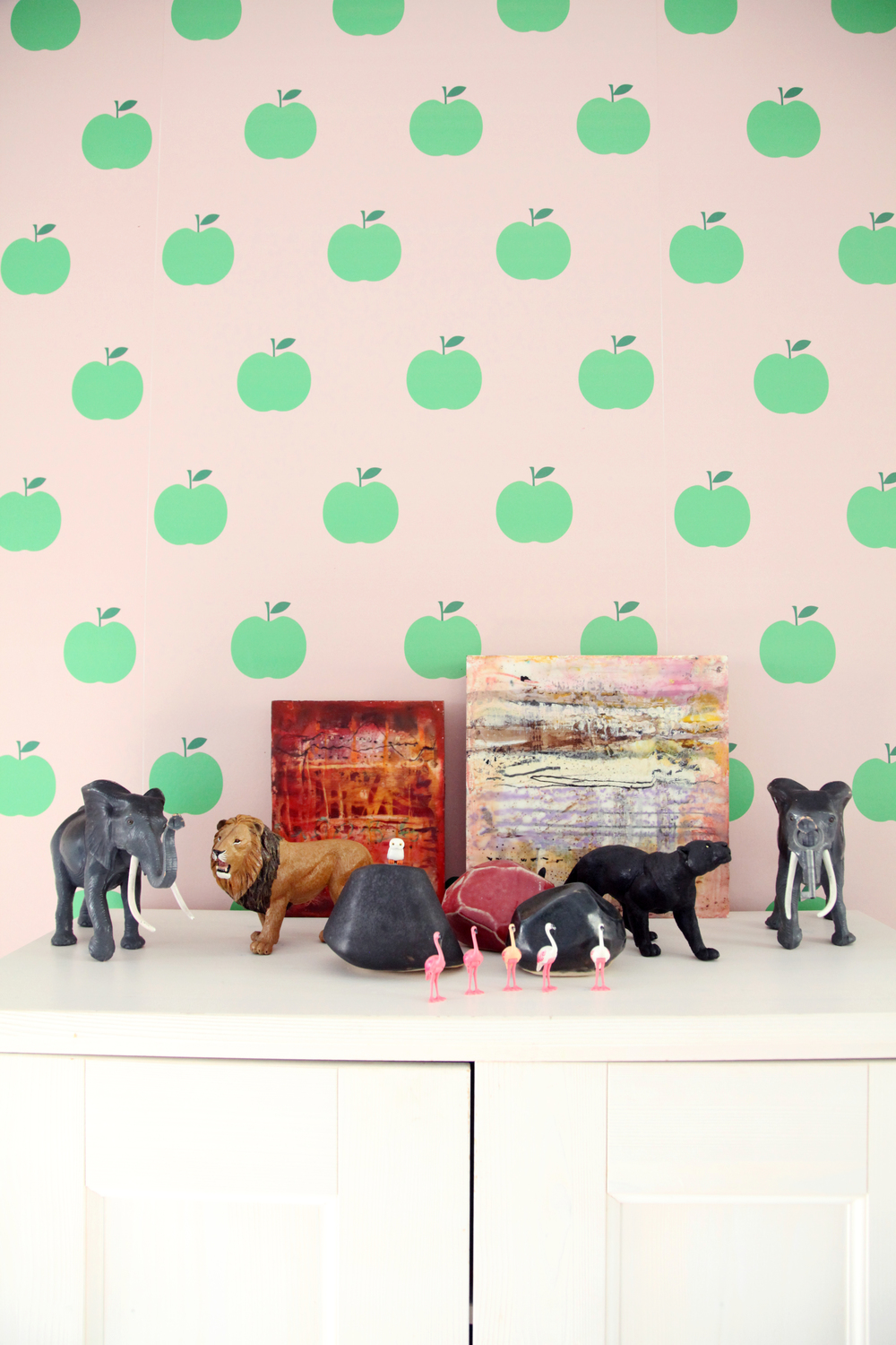 A funny little menagerie against the most darling wallpaper.