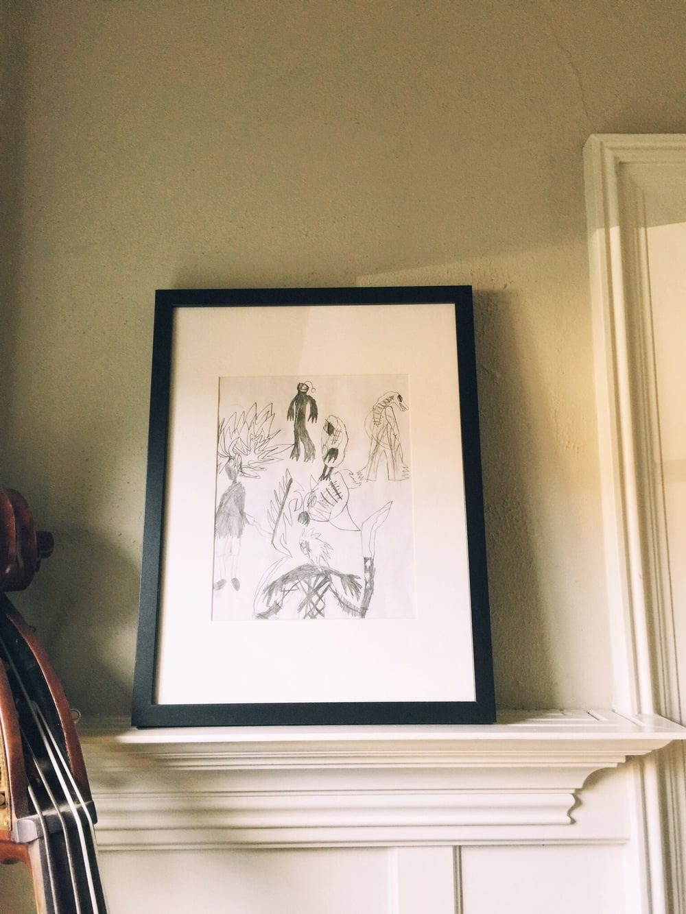 "The black and white pencil drawing was done by Adrienne's son, Gabriel when he was 9. (called ""Gods and Monsters"")."