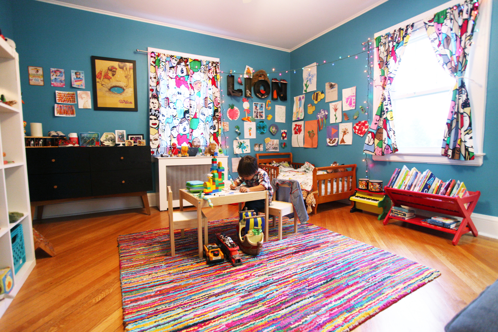 Creativity and play is fostered by a center art-table and gallery-like walls.