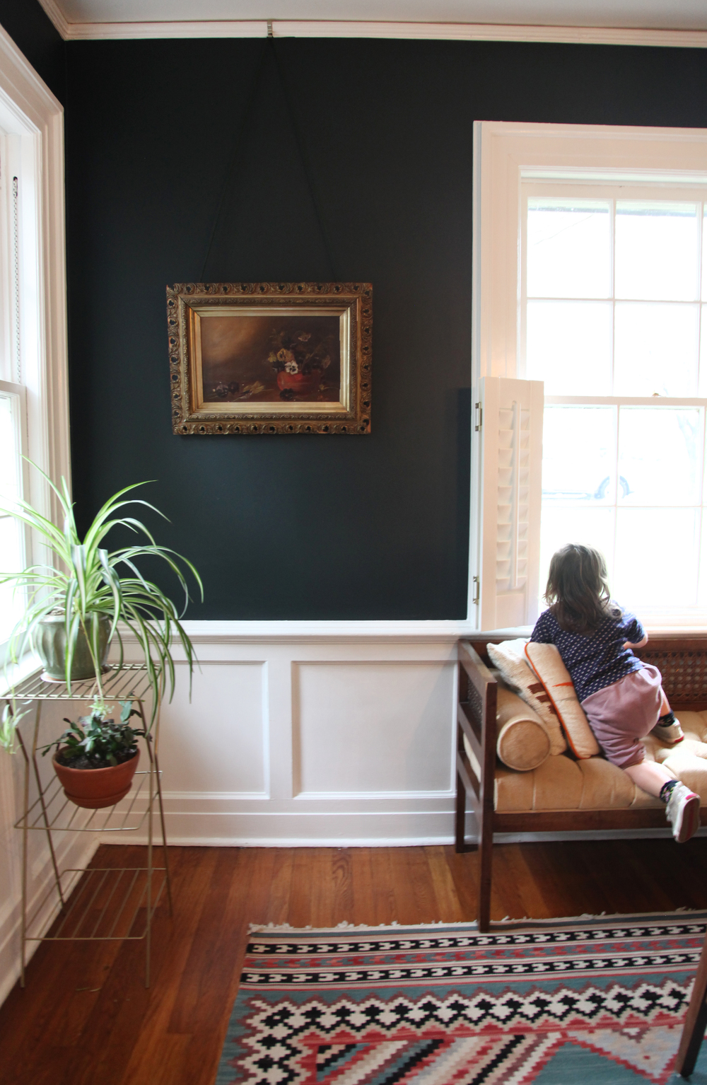 """Both the painting and the little sofa Iris is on are from   Bogwater Jim   our favorite antique shop up in Sussex County. """