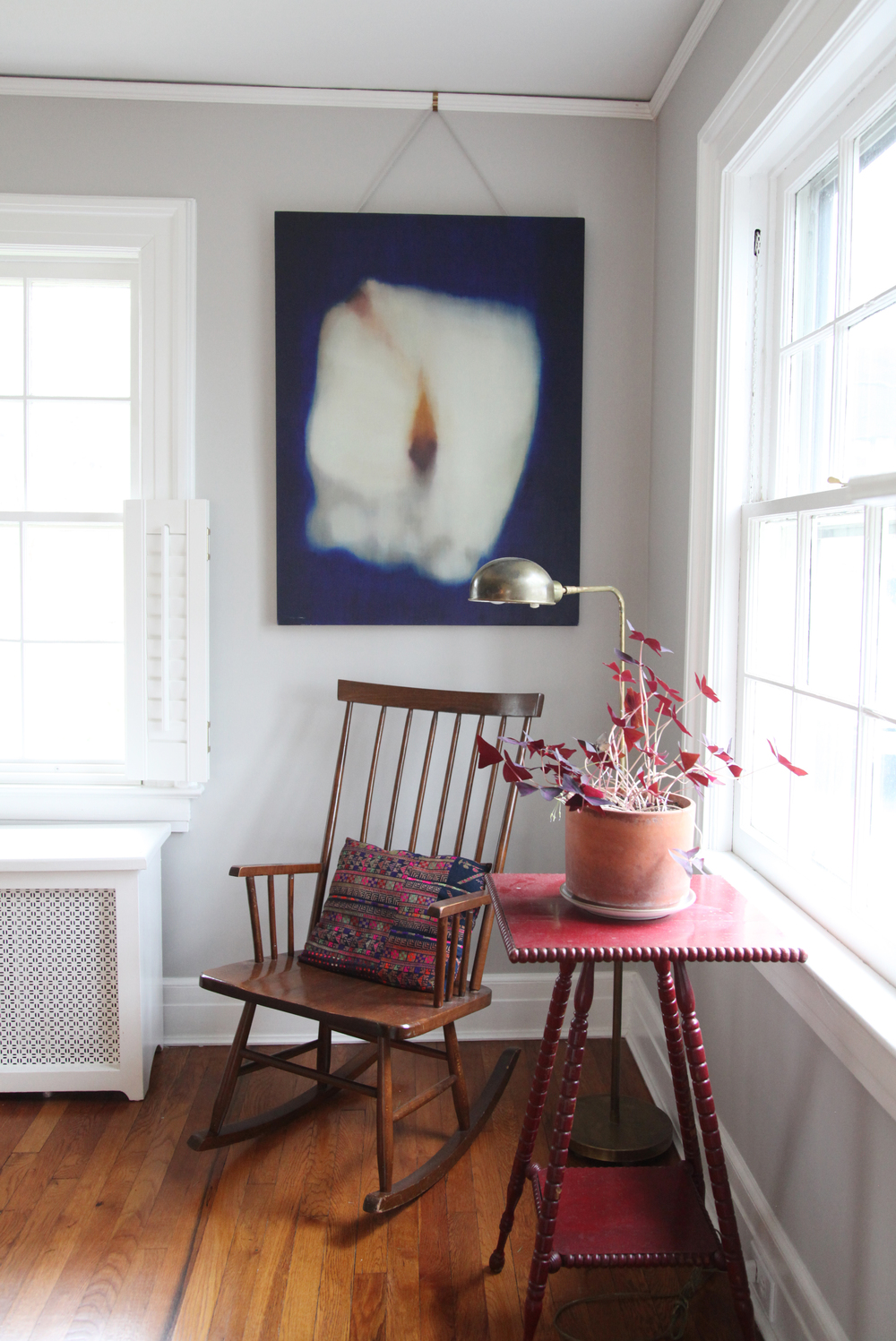 """Our friend Tucker Capparell made the painting, one of my favorite things. We use the picture rails that are original to the house. We get the hooks from   Rejuvenation   online and different colored cords for each room from M&J Trimmings in the garment district."""