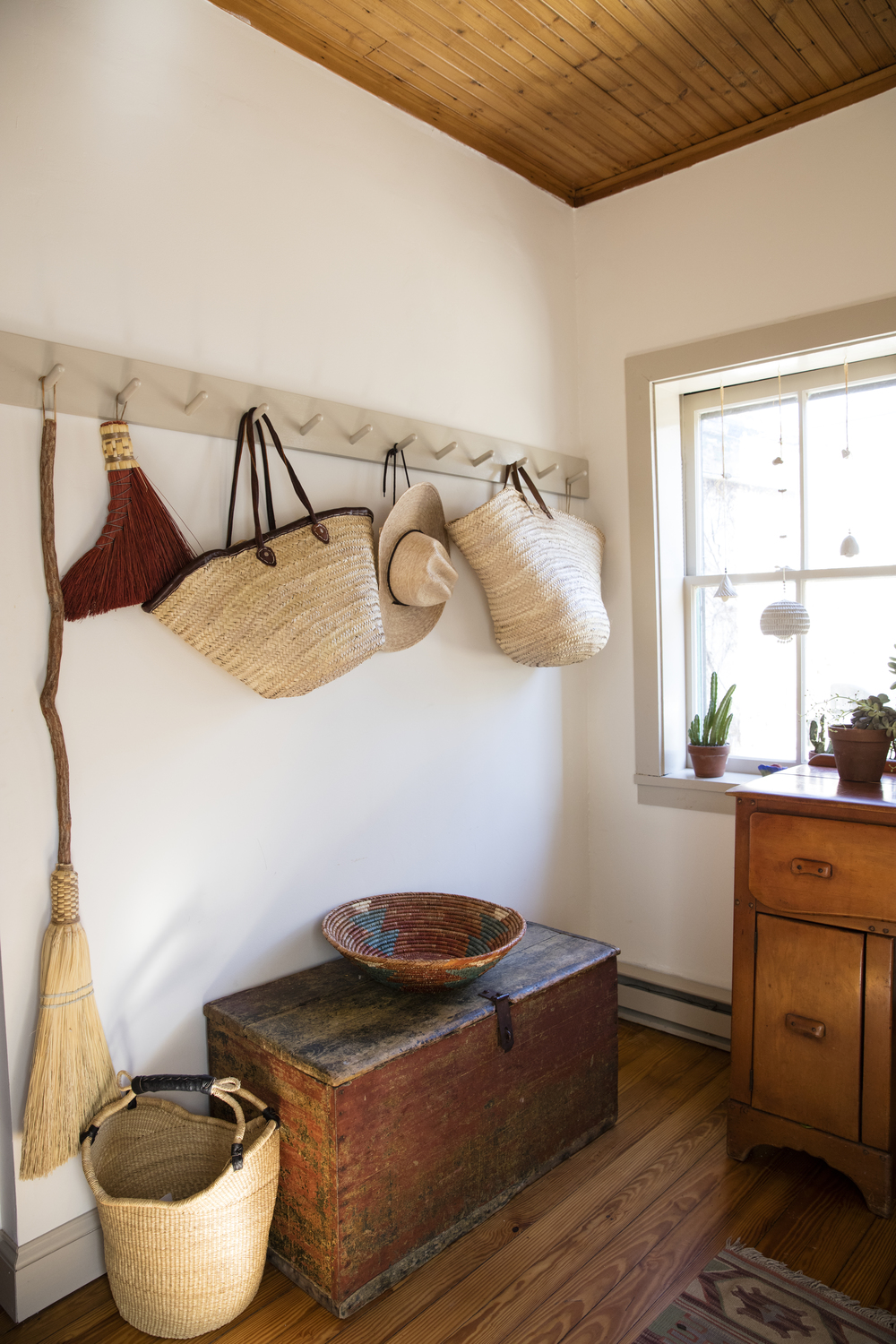 Pretty brooms and basket-storage.