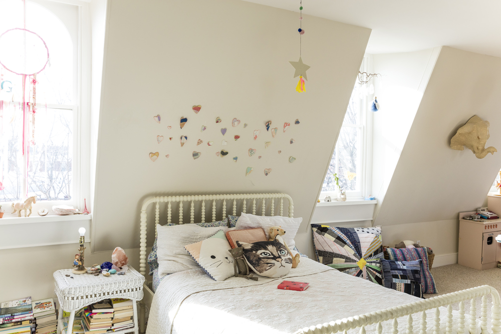 Paper hearts, pretty mobiles, and endless book stacks make for a dreamy girlish escape.