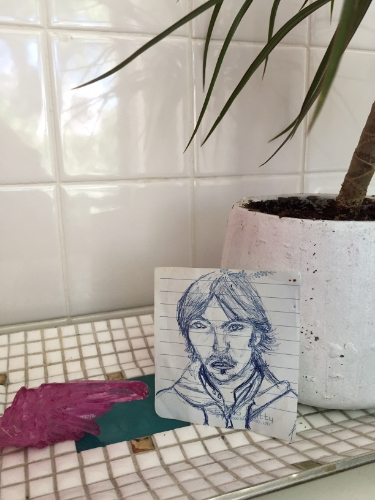 Lisa sketches a portrait of Michael.