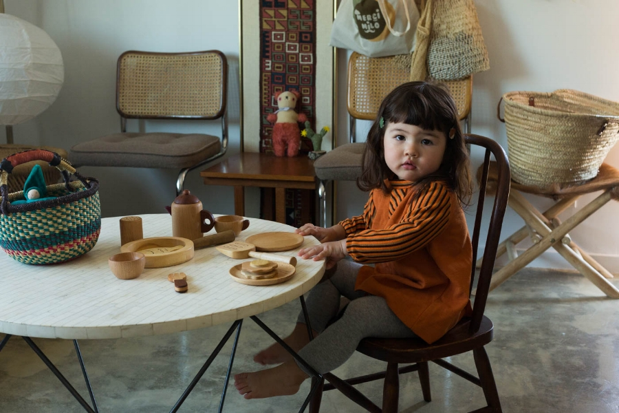 Adorable Milo with her Wooden Chef Set. All photos by Caroline.