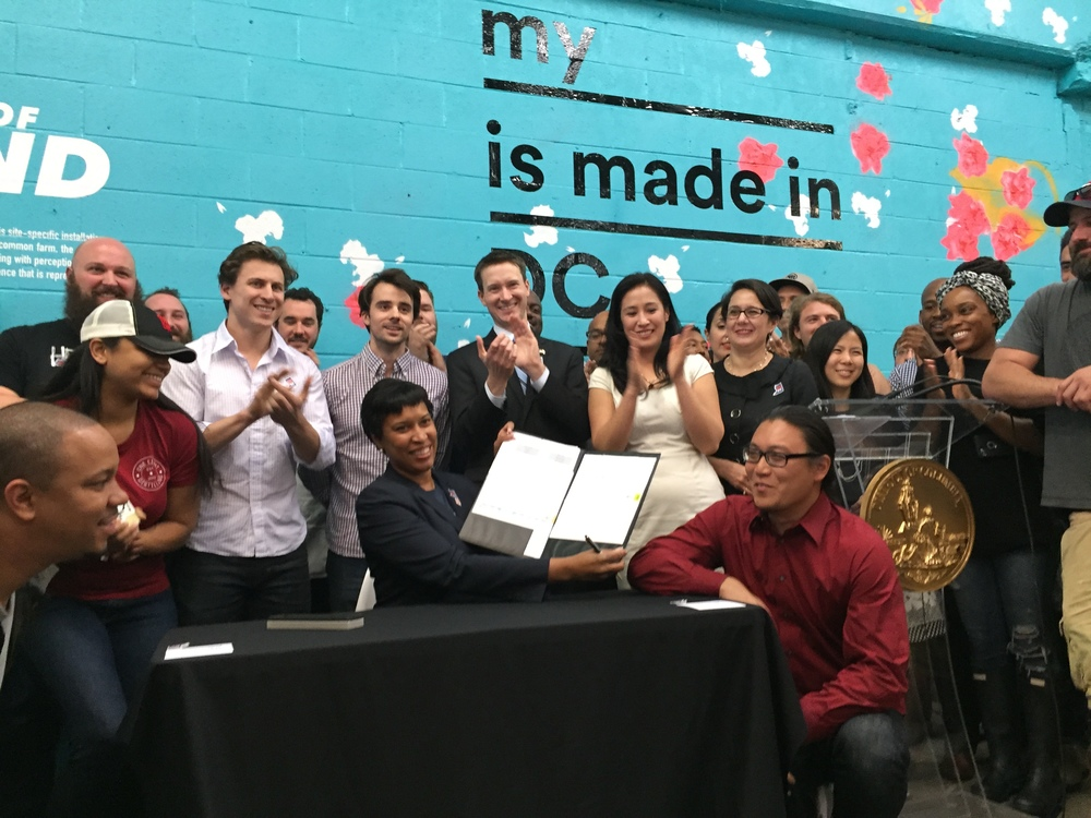 Mayor Muriel Bowser signing the Made in DC bill. Photo via