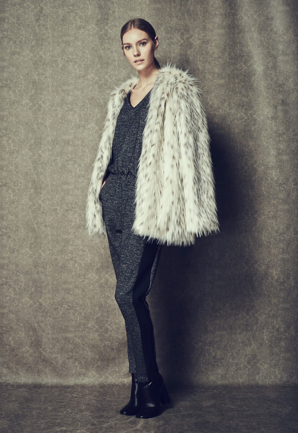 Dalmatian Fur Coat & Mottled Knit Jumpsuit