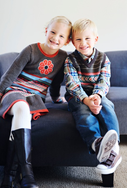 This is a great example of matching and it working really well. Siblings wearing something from the same line but in different patterns.  Great job of coordinating outfits but not too matchy matchy and good use of mixing patterns.