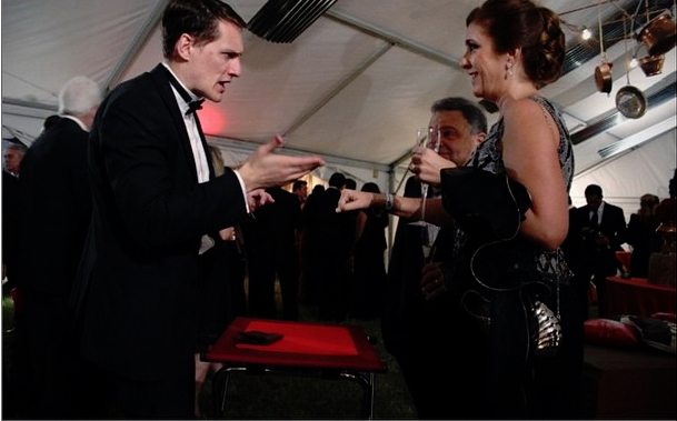 Nick Paul performing strolling magic for a black tie event in Florida.