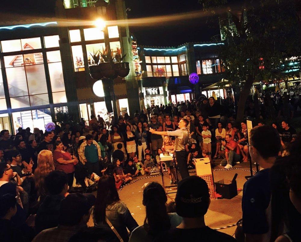 Nick Paul performing at Downtown Disne