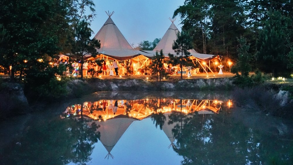 Wedding Tipi Event Tents Lit Up at Night