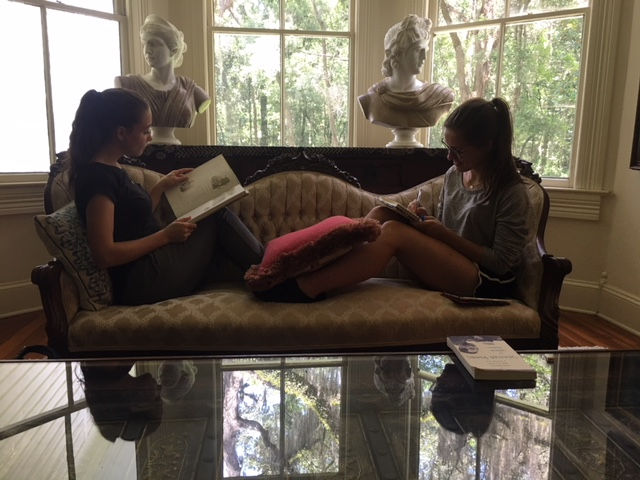 Jana and Klara reading in the library at the Reid House Farm.