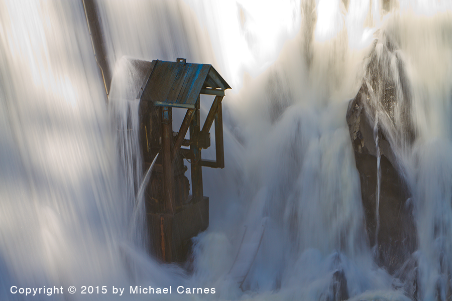 Water pounds on a valve at the Lake Tahoma dam