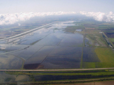 Looking south down the Yolo Bypass from over Interstate 80 during a flood event in April 2012. Photo courtesy Curt Schmutte, Curt Schmutte Consulting