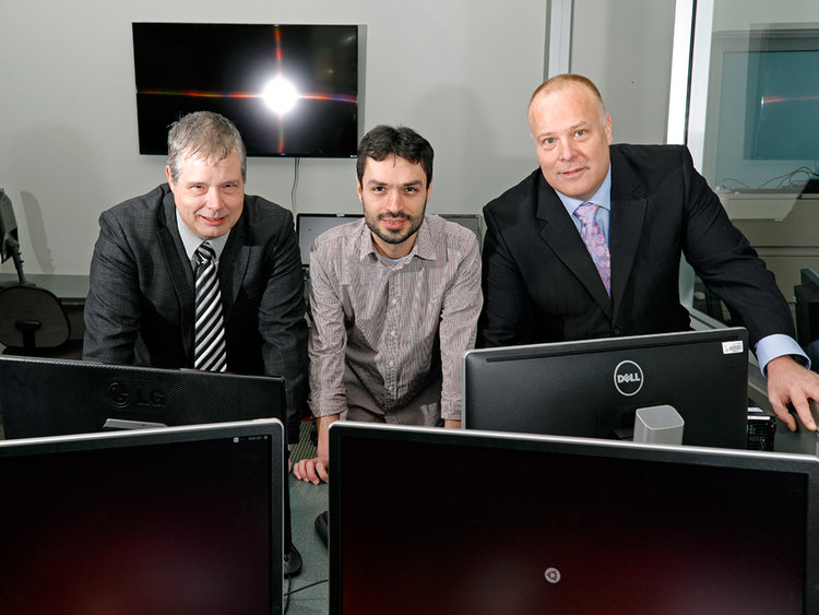 PFM Scheduling Services team, from left: CEO Maurice Sevigny, research developer Amin Jorati and COO Jason Harder, at the University of Alberta. Photo Credit: Financial Post.