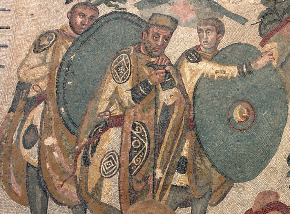 A late Roman military commander and two soldiers, from the 'Great Hunt' mosaic in the villa of Piazza Armerina, Sicily. Early 4th century AD