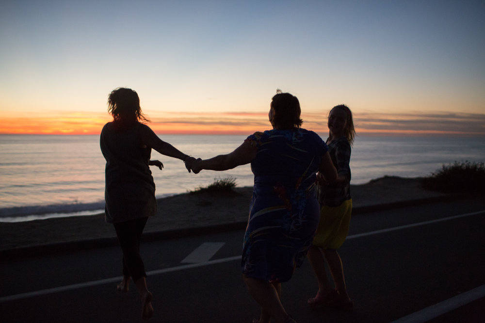 The Mousseau's run across the road to catch the last rays of sunlight. Carlsbad, CA.
