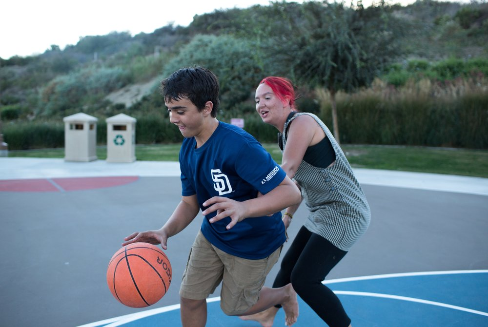 Ben and Koda play a friendly game of basketball in Encinitas, CA.