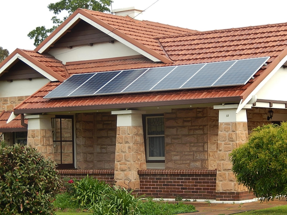 Solar panels can help homeowners reduce emissions, but perhaps more importantly, they can be a sensible economic investment. Michael Coghlan/Flickr (CC BY-SA 2.0)