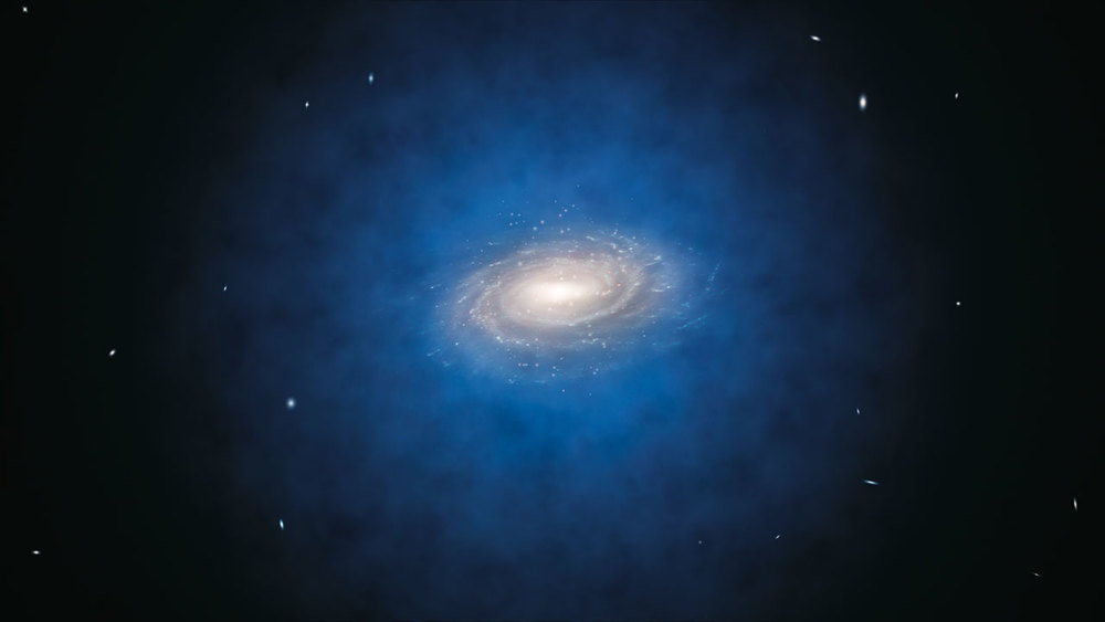 This artist's impression shows the Milky Way galaxy. The blue halo of material surrounding the galaxy indicates the expected distribution of the mysterious dark matter.   ESO/L. Calçada  (CC BY 4.0)