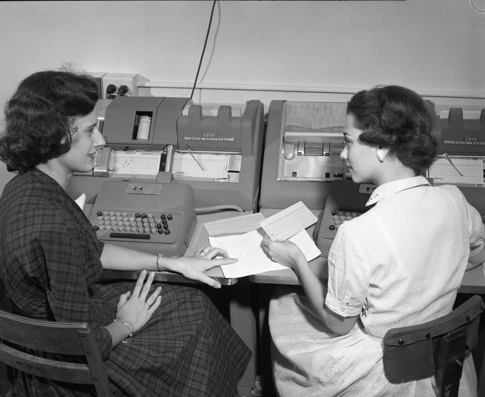 Two women discussing their work while entering data onto punched cards at Texas A&M in the 1950s.   Cushing Memorial Library and Archives/Wikipedia Commons  (CC BY 2.0)
