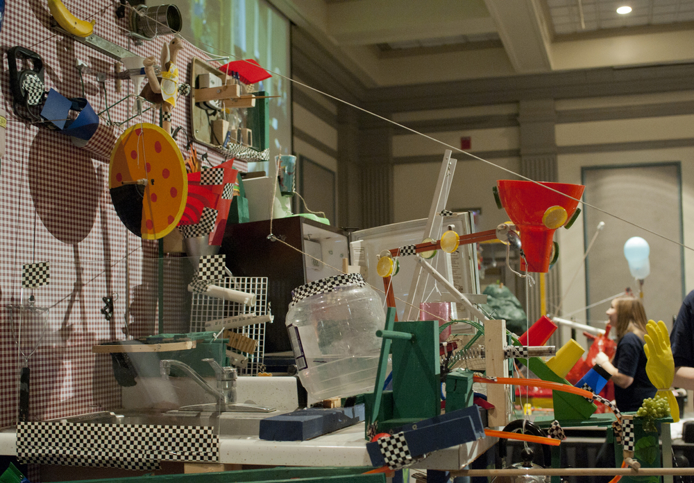 Rube Goldberg machines are intricate displays of engineering prowess, designed to achieve a goal by the transfer and transformation of energy throughout a system of levers, pulleys, domino effects, gravitational potential energy, heat transfer and so forth. Penn State/Flickr (CC BY-NC 2.0)