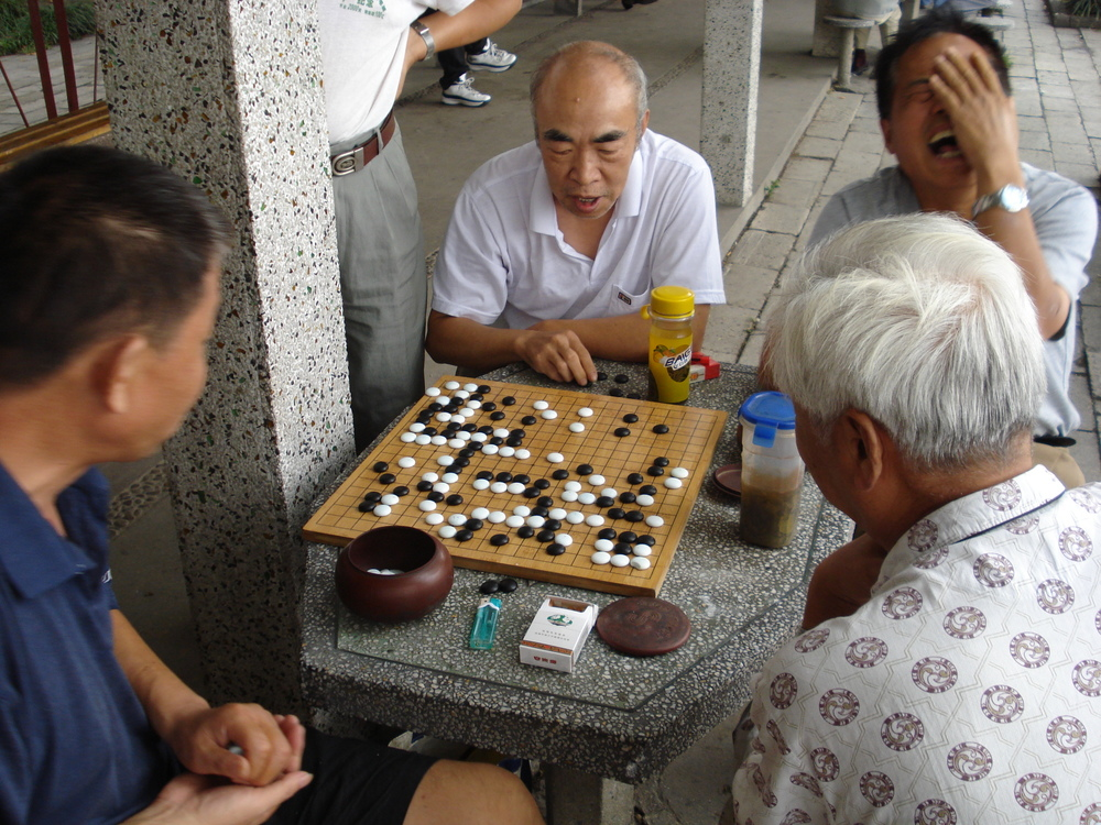 Men playing Go in Shanghai. Currently about 60 million people play Go worldwide. J.A.G.A/Flickr (CC BY-NC-ND 2.0)