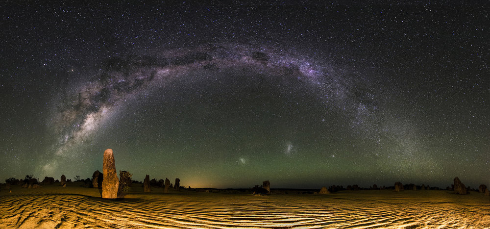 The bright band of the Milky Way over The Pinnacles desert in Western Australia. Throughout history, the motion of the stars has mystified and intrigued us sparking astronomers and astrologers to search for meaning. inefekt69/Flickr (CC BY-NC-ND 2.0)