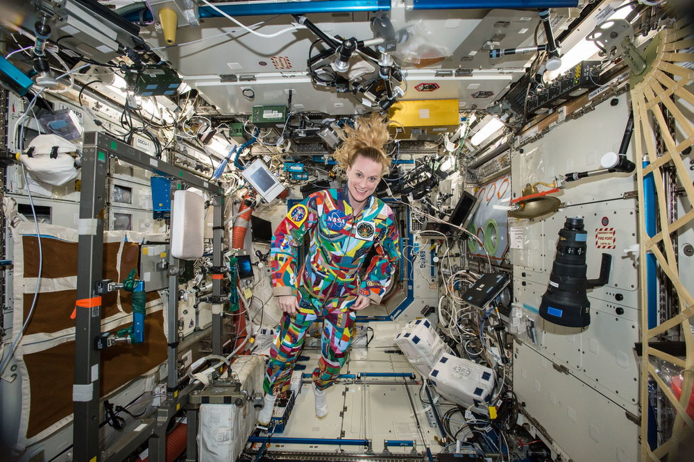 Astronaut Kate Rubins on board the ISS, wearing a hand-painted space suit from the Space Suit Art Project.   NASA  (CC BY-NC 2.0)