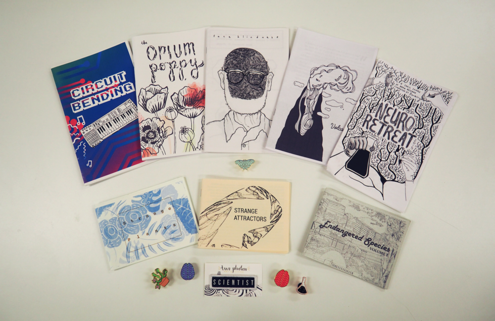 A selection of Two Photon's zines and art projects, covering a range of science topics.  Image used with permission.