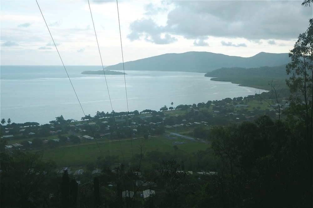 A view of the Aboriginal Shire of Yarrabah from the hills above on a rainy day. © Ellen Rykers (used with permission)