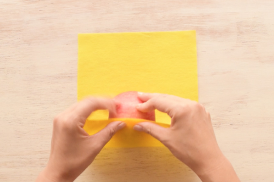 Step 1: Cut your yellow paper to an appropriate size (enough to cover the surface of the fruit).
