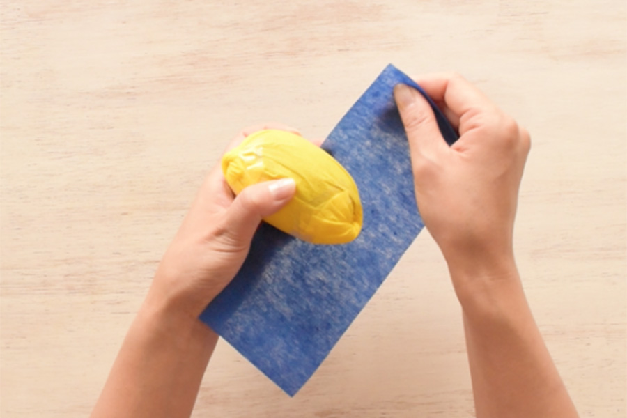 Step 1: Cut your blue paper to the size you can wrap the bottom half of your fruits.
