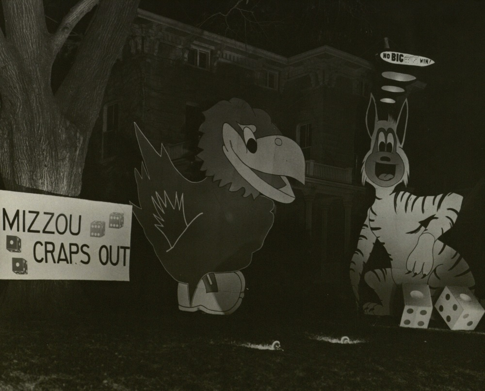 Homecoming decorations %22Mizzou craps out%22 (1950s), night.jpg