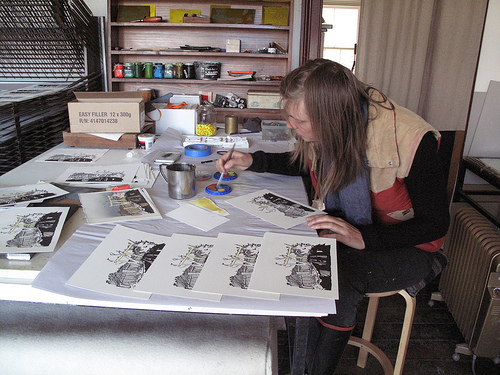 Artist Wendy Murray hand-colouring her edition print 'Haefligers' at Hill End Press, April 2010