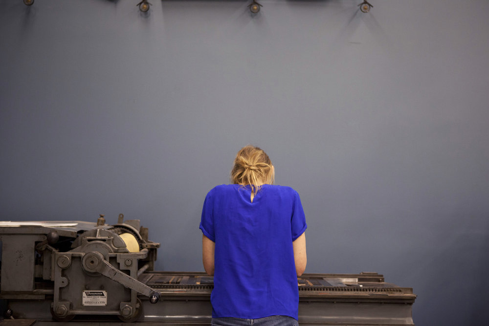 Day 6 at  The International Printing Museum : Busy on the Vandercook. Photo: Louise Hyatt