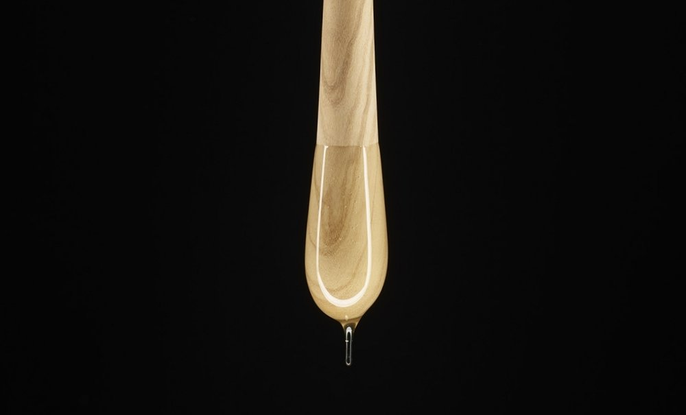 Olive Wood Goûte dripping honey.  Photo: Orion Dahlmann